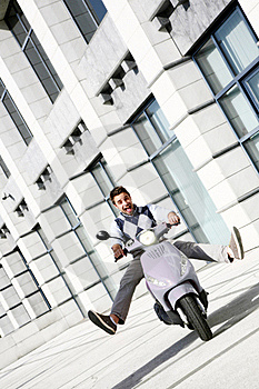 Young Happy Man On Scooter Stock Image - Image: 19134231