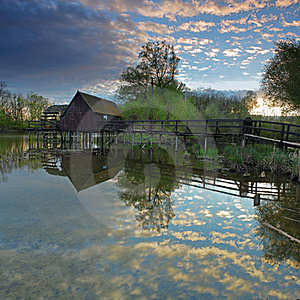 Clouds Reflection In Water With Watermill Royalty Free Stock Image - Image: 19172266