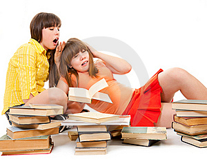 Two Schoolgirls Were Tired Of Reading Books Royalty Free Stock Images - Image: 19181579