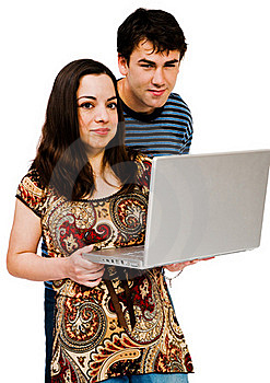Couple Using A Laptop Royalty Free Stock Image - Image: 19182376