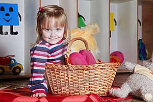 Little Girl With Basket Playing Stock Photography - Image: 19191452