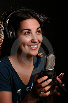 Girl With A Microphone And Head-phones Stock Photography - Image: 19192522