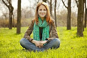 Beautiful Girl Sitting At Green Grass At Park. Royalty Free Stock Images - Image: 19199659