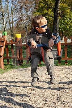 Boy With Sunglasses On Swing Stock Image - Image: 19199891