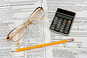 Glasses, pencil and calculator Stock Photo