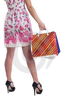 Tall Woman Legs With Stiped Shopping Bags Royalty Free Stock Image - Image: 19203586