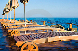 Sun Loungers On A Beach With A Parasol. Stock Photography - Image: 19224812