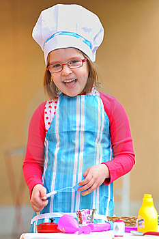 Little Girl Having Fun Playing Cooking Royalty Free Stock Photo - Image: 19227915