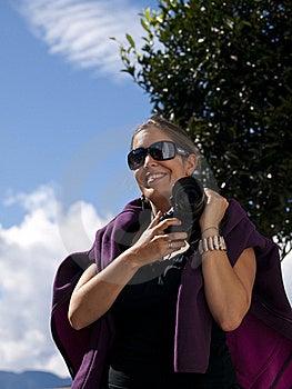 Beautiful Girl Holding A Digital Dslr Camera Stock Photo - Image: 19229980
