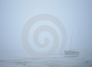 Sailing Boat In Milky Fog Royalty Free Stock Photo - Image: 19230575