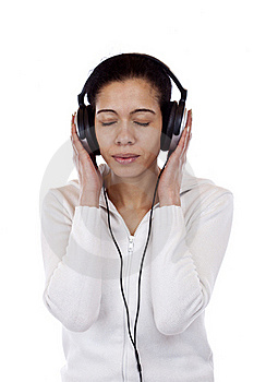 Attractive Woman With Headphones Listens To Music Stock Photography - Image: 19243012