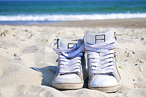 Sneakers On The Beach Stock Photo - Image: 19243550