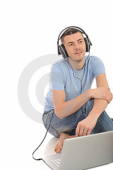 Young Man Listening To Music In Headphones Stock Images - Image: 19253544