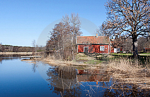 Swedish Red  House At A Lake. Stock Photos - Image: 19285763