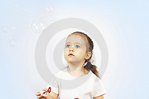 The Girl Starting Up Soap Bubbles Royalty Free Stock Image - Image: 19291136