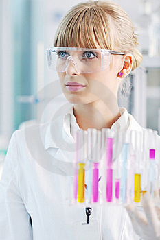 Female Researcher Holding Up A Test Tube In Lab Royalty Free Stock Image - Image: 19297026