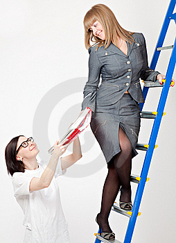A Woman On A Stepladder With Papers Stock Image - Image: 19300621