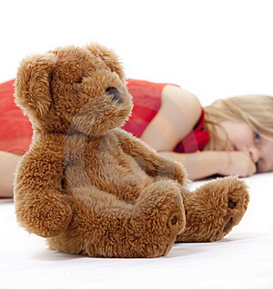 Teddy Bear And Resting Girl Royalty Free Stock Image - Image: 19331686