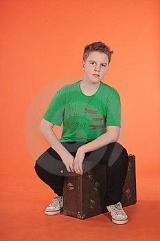 Boy Sitting On Suitcase Royalty Free Stock Images - Image: 19336099