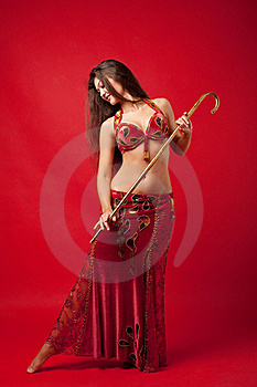 Young Woman Dance With Cane In Red Arabic Costume Stock Photography - Image: 19359942