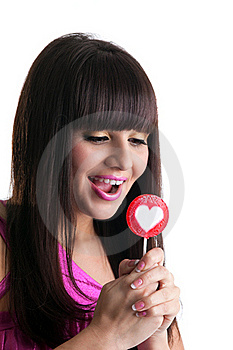Young Brunette Woman Look At Heart Lollipop Royalty Free Stock Photos - Image: 19359958