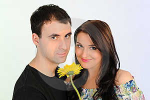 Lovely Romantic Couple With Flower Embracing Stock Photo - Image: 19361260