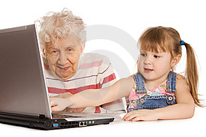 Grandmother With Grand Daughter At The Computer Royalty Free Stock Images - Image: 19362249