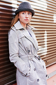 Woman In A Raincoat Stock Photos - Image: 19362523