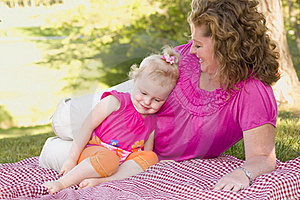 Mother And Daughter On Blanket In The Park Royalty Free Stock Image - Image: 19365556