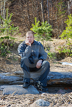 Man Sitting On A Log Royalty Free Stock Photography - Image: 19366837