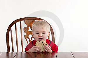 Toddler Boy Looks At Cookie With Open Mouth Stock Photo - Image: 19368300