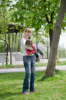 Mother And Little Daughter On Nature Royalty Free Stock Image - Image: 19385276