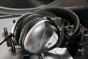 Dynamic Closed Headphones On Mixer Royalty Free Stock Image - Image: 19387556