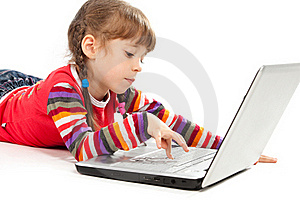 Little Girl With A Laptop Royalty Free Stock Photo - Image: 19387785