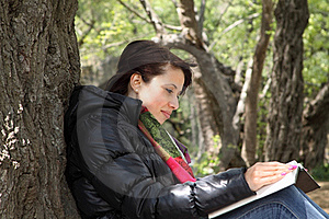 Girl Reading Book By A Tree Stock Photography - Image: 19389652