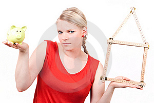 Young Woman With House Symbol And Piggy Bank Stock Photography - Image: 19396502
