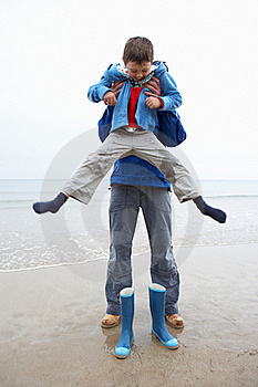 Father And Son On Beach Stock Images - Image: 19419684
