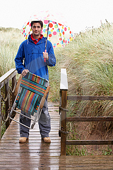 Young Man With Umbrella Royalty Free Stock Image - Image: 19421156