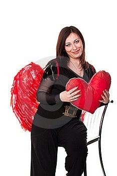 La Belle Femme Avec Le Coeur Rouge Dans L'ange Rouge S'envole Photos libres de droits - Image: 19441098