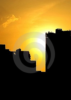 Summer Sunset With Silhouette Of Buildings Stock Photos - Image: 19441633