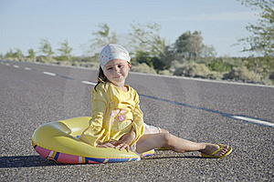 Little Girl Sitting On Asphalted Road Royalty Free Stock Images - Image: 19442639