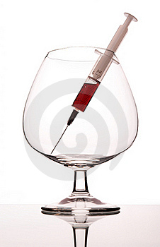 Syringe In Wineglass Royalty Free Stock Photos - Image: 19449048