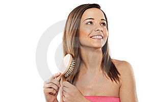 Lovely Woman With Hairbrush Royalty Free Stock Photos - Image: 19450368