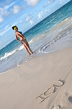 Tanned  Woman On The Beach With Words I Love You Royalty Free Stock Images - Image: 19451519