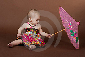 A Little Girl A Pink Umbrella Royalty Free Stock Photo - Image: 19459035