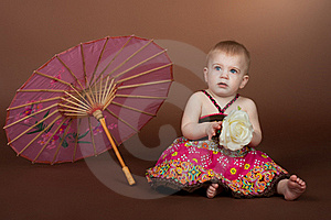 A Little Girl With An Umbrella Stock Image - Image: 19463451