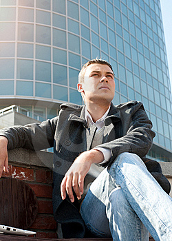 Man Sitting On A Bench In Front Of A Building Stock Images - Image: 19478894