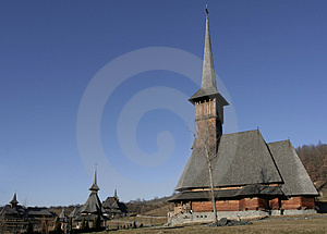 Wooden Monastery And Wooden Church In The Foreground Royalty Free Stock Images - Image: 1951209