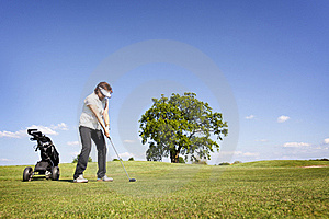 Woman Focusing On Golf Fairway. Stock Image - Image: 19500361