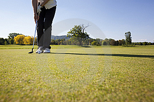 Female Golf Player Putting Ball. Royalty Free Stock Photos - Image: 19500398